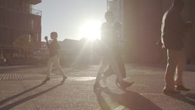 Office going people commuting on bright sunny morning. Business people in hurry to reach office stock video footage