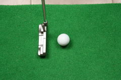 Office golf. Golf ball and putter Royalty Free Stock Photo