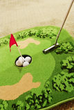 Office golf - golf ball and putter Stock Photography