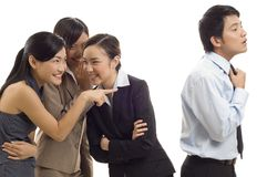 Office Gossip 1. Three attractive young asian businesswomen gossip about one of their colleagues Royalty Free Stock Images