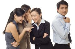Office Gossip 3. Three attractive young businesswomen gossip about a male co-worker Stock Image