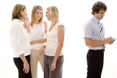 Office Gossipping. Three business women gossip and joke about a male colleague Stock Photography
