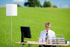 Office on green meadow Royalty Free Stock Photography