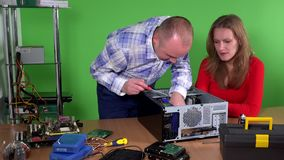 Office guy fixing female computer. man and woman flirting at work stock video footage