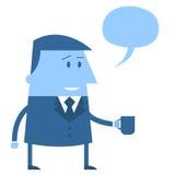 Office guy holding mug with speech balloon Stock Photos