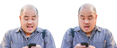 An office guy recieve a message via smartphone. He Royalty Free Stock Photos