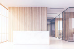 Office hall with panoramic windows and light wooden and glass walls of meeting rooms. Stock Photo
