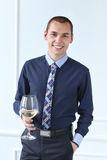 Office. Happy man with glass of champagne Stock Images