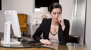Office Worker Endures Headache at Work Station Stock Photography