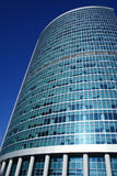 Office highrise. High and modern office building over deep blue sky Stock Photo