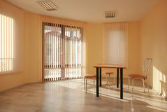 Office interior. Sunny empty office room interior Royalty Free Stock Photo
