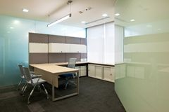 Office interior. Interior of an office with wall mirror Stock Image