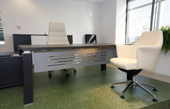 Office interior. Interior of office with desk and chairs on green floor royalty free stock photo