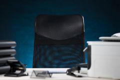 Office interior with empty chair. And office supply Stock Photography
