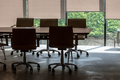Office interior fragment with conference  table and armchairs Royalty Free Stock Images