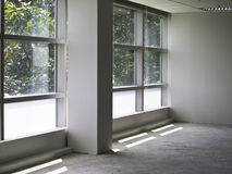 Office interior with glass wall. And nature Royalty Free Stock Image