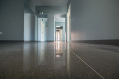 Office interior, new building. Office interior, floor with reflections Royalty Free Stock Photo