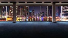 Office interior with panoramic windows. Revealing Dubai cityscape stock image