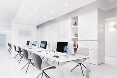 Office interior with a row of chairs, long table and computers Royalty Free Stock Photos
