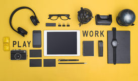 Office items tablet hero header. Creative black office items tablet hero header on yellow colored background Royalty Free Stock Image
