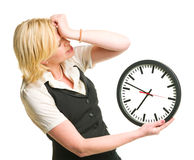 Office lady with a clock Royalty Free Stock Photos