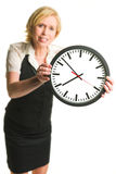 Office lady with a clock Royalty Free Stock Image