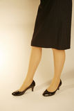 Office lady feet with heels. Office lady standing with black skirt and black heels Royalty Free Stock Image