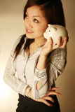 Office lady holding piggy bank Stock Photos
