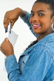 Office lady stepping some papers. Smiling young office lady stepping some papers Royalty Free Stock Photo