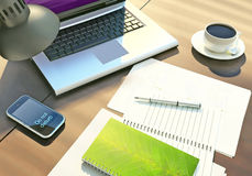 The office. The laptop, phone, a cup of coffee and documents on a wooden table. Royalty Free Stock Image