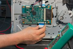 Office laser printer diagnostics and repair, disassembly circuit board. In servise stock photography
