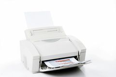 Office laser printer. Printed sales reports on white background stock photography