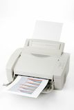 Office laser printer. Printed sales reports on white background stock photos