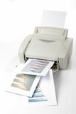 Office laser printer. Printed sales reports on white background royalty free stock photo