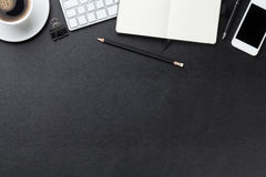 Office leather desk with computer, supplies and coffee Stock Image