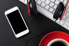 Office leather desk with pc, smartphone and coffee cup Royalty Free Stock Photos