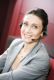 Office life. Young switchboard operator representative smiling Royalty Free Stock Images