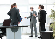 Office life. business team discussing a new business plan in mod Royalty Free Stock Images