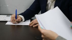 Office life concept. Close up of hands signing papers. Shot in 4k stock footage