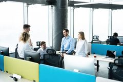 Office life. Group of young business people working and communicating together in creative office. royalty free stock photography