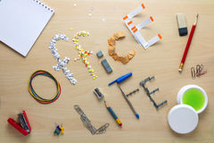 Office life iscription on a wooden desk laid out of office stationery. Office clerk's weekdays. Stock Photography