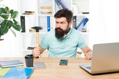 Office life makes him crazy. Businessman with beard and mustache gone mad with hammer in a hand. Angry aggressive stock photos