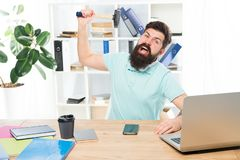 Office life makes him crazy. Businessman with beard and mustache gone mad with hammer in a hand. Frustrated office. Worker holding hammer poised ready to smash stock photography