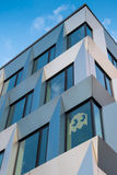 Office life. Modern office building with Pac-Man art on window (Post-it note war royalty free stock images