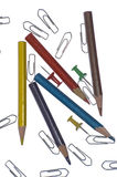 Office lifestyle. Close-up of office lifestyle: colour pencils, staple, drawing pin royalty free stock images