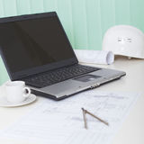 Office light workplace of engineer with laptop Royalty Free Stock Images