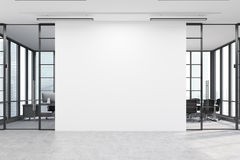 Office lobby with a large white wall and two meeting rooms. Office lobby. Large white wall is in the middle with two conference rooms by both sides. 3d rendering Stock Photos