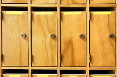 Office lockboxes. Wooden mailboxes with metal lock in office building or school Stock Images