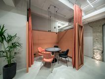 Office in loft style with orange meeting zone Stock Photo