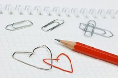Office Love. Two paper-clips, formed to as a heart Stock Photo